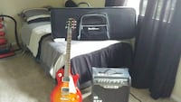 sunburst telecaster guitar; black guitar amplifier; grey keyboard case 65 km