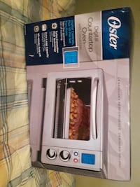 Oster digital countertop oven with convection box London, N6H 1T3