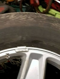 4 rims all aluminum two with tires on Surrey, V3V 3S1
