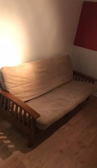 brown wooden framed brown padded futon 60 km