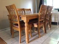 brown wooden dining table set Montréal, H1N 2X3
