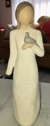 Peace Figurine of Woman with her Bird North Port, 34287