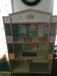 brown and pink wooden dollhouse 47 mi