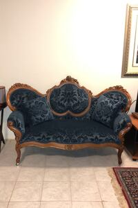 Blue Velvet Antique Sofa with intricate wood carvings and rolling feet Silver Spring, 20902