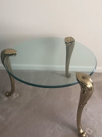 Glass end table with brass legs.  Also selling matching sofa and coffee tables. Upper Marlboro, 20774