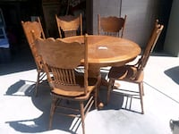 round brown wooden table with five chairs  Bakersfield, 93308
