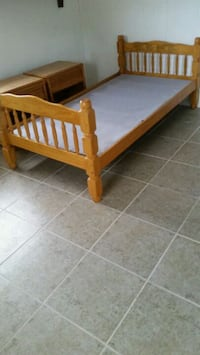 brown wooden bed frame with white mattress Plant City, 33563