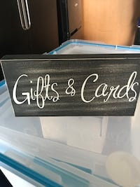 black gift and cards wooden wall decor