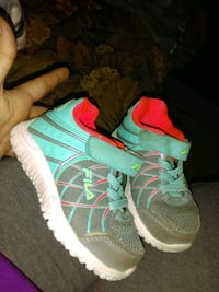 pair of green-and-pink Nike running shoes Odessa