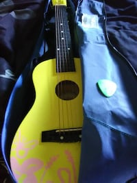 yellow and black acoustic guitar 17309