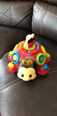 toddler's yellow and red ride on toy