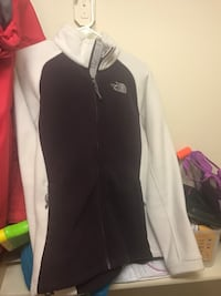 Thick woman's medium fleece north face. Colors are cream and plum. Excellent condition. Wasilla, 99654