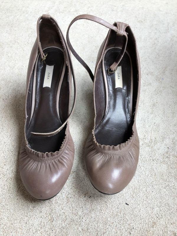 pair of gray leather peep-toe heeled shoes 1