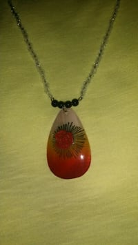 silver and red gemstone pendant necklace
