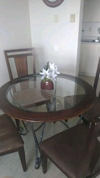 round brown wooden framed glass top table London, N6A