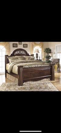 Brown wooden bed frame with white mattress New York, 11435
