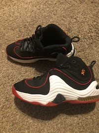 pair of white-and-black Nike basketball shoes Houston, 77085