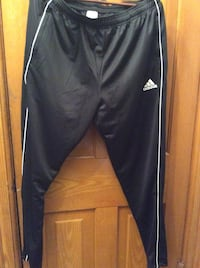 Adidas  Tapered Fit Pants. size XL. - New Side Pockets and lower legs zippers Kitchener, N2H 5P4
