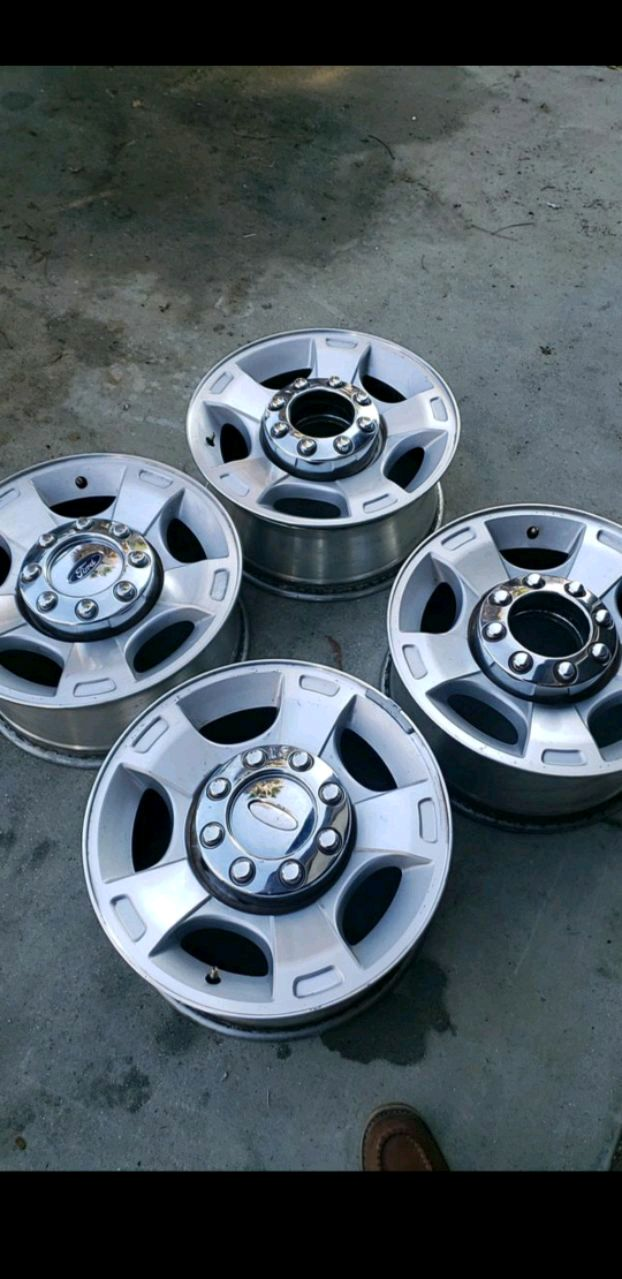 Photo 4 18 inch 8-170 factory ford wheels with caps and lugs