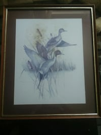 Duck painting with brown wooden fr