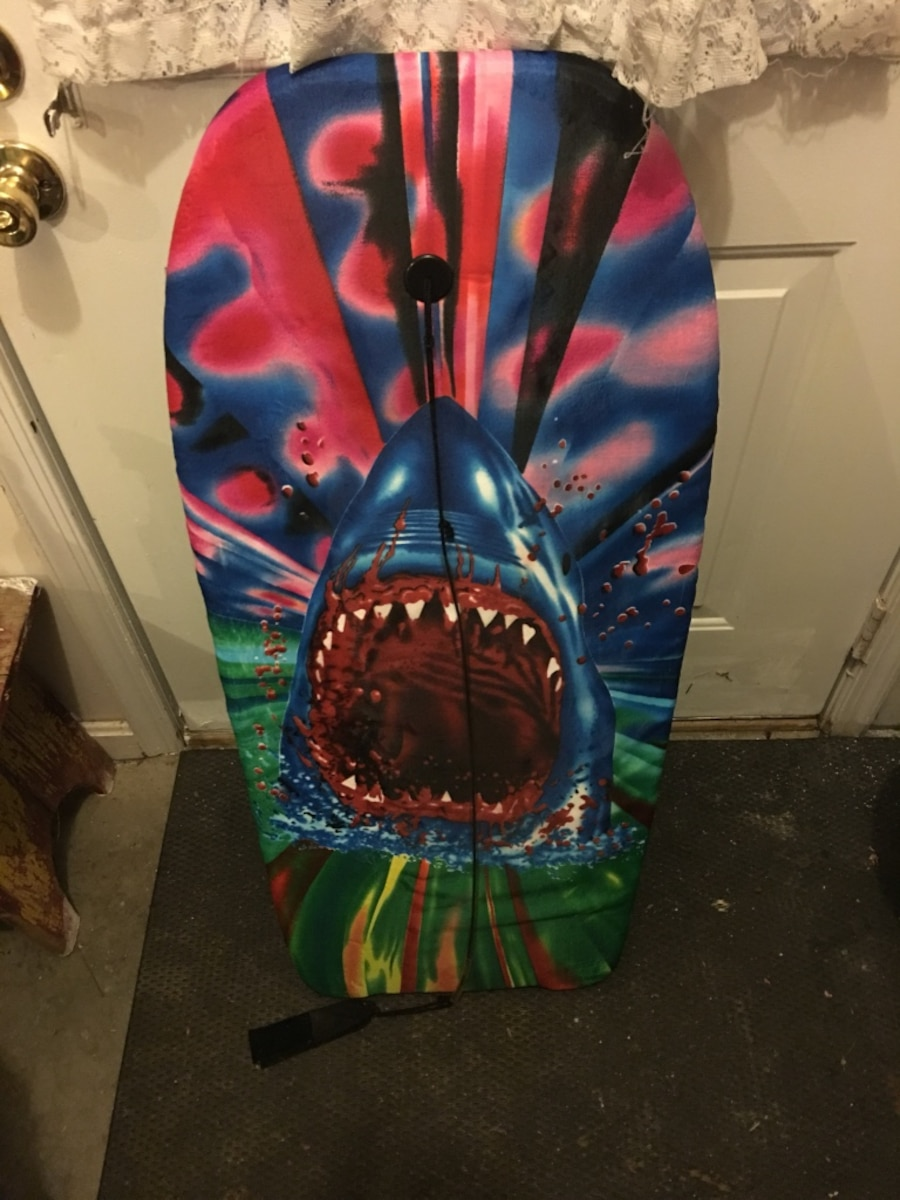 green, black, blue and red shark print wake board