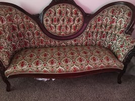 Beige and white floral fabric chesterfield sofa