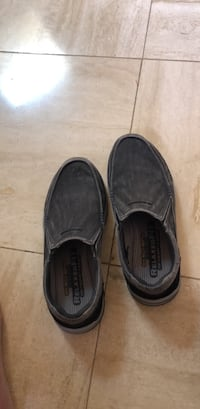 pair of gray suede slip-on shoes Boca Raton, 33498