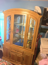 Brown wooden framed glass display cabinet Falls Church, 22043