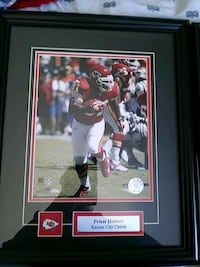 Priest Holmes photo with black wooden frame