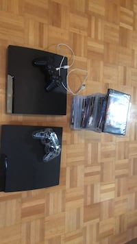 Black sony ps3 slim console with controller and game cases  Toronto, M9W