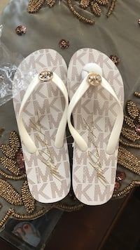 pair of white-and-brown leather sandals Sterling Heights, 48314