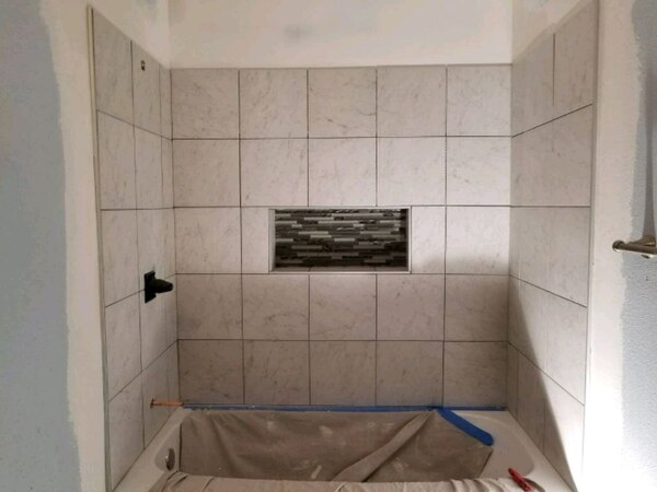 installation of tile on the wall and vinyl. a1055da2-cf3e-42a9-a443-849ea6cfea4f