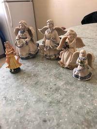 four white and one yellow ceramic female figurines Winnipeg, R2K 4A1