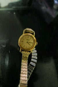 round gold analog watch with link bracelet Toronto, M1K 3R1