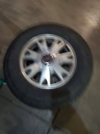 1998 GMC Jimmy rim and tire other rim same car.