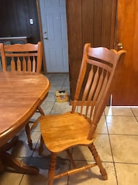 Wood Oval table and 4 chairs  very good condition - negotiable