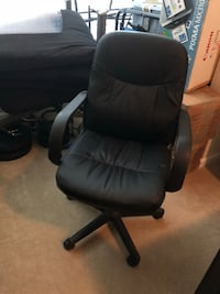 Black leather office rolling armchair Rockville, 20851