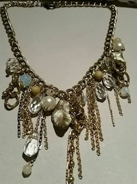 Gold tone neckace with variety of bits and cristals  with liefes and c Oshawa, L1H 7K5