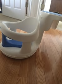 white and blue Safety1st plastic bath seat