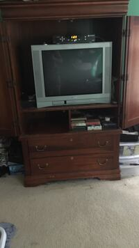 Gray crt tv ; brown wooden tv console Sterling, 20165