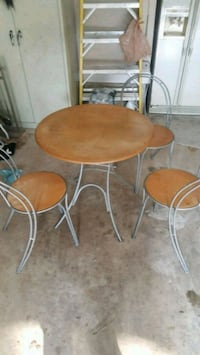 round brown wooden table with two chairs Alexandria, 22310
