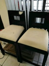 two white padded brown wooden chairs Miami, 33175