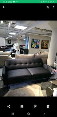 black leather sofa set with coffee table
