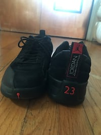 Pair of black air jordan basketball shoes Miami Shores, 33138