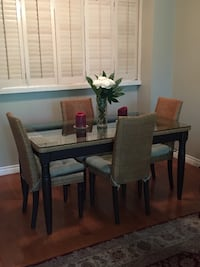 Wood wicker and glass top dining room table with 6 chairs and cushions Eastvale, 92880