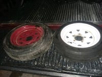 two white bullet hole car wheels with tires Orlando, 32837