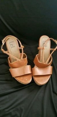 pair of brown leather open toe ankle strap sandals Kissimmee, 34741