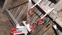 gray and red harness and red and white metal tool Baltimore, 21230