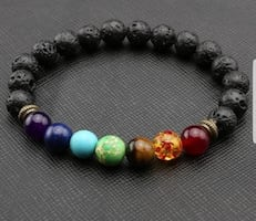 CHAKRA LAVA STONE BRACELET  Can hold perfume /essential oils ..