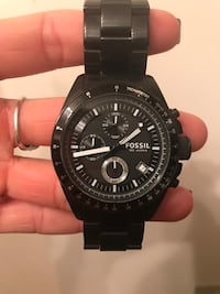 Round black Fossil chronograph watch with link strap